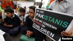 In Karachi on December 19, students protest to demand justice for the victims of the Taliban attack on a school in Peshawar.