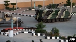 Yemeni armored personnel carriers are deployed outside the Central Bank in Sanaa on March 21.