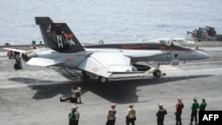 An F/A-18E Super Hornet on the flight deck of the aircraft carrier USS Nimitz