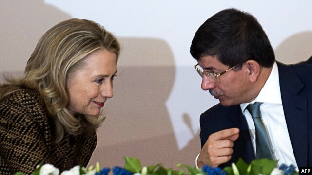 Turkish Foreign Minister Ahmet Davutoglu speaks with U.S. Secretary of State Hillary Clinton in Istanbul earlier this month.