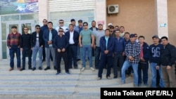 Kazakhstan, Aktau. Complaining workers gathered at Sinopec office. 24 Sept 2019.