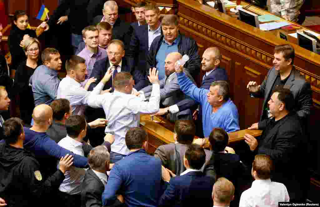 A scuffle breaks out in the Ukrainian parliament on October 6, 2017. The melee erupted over a law regarding Ukraine's state sovereignty in separatist-held territory in the east of the country.