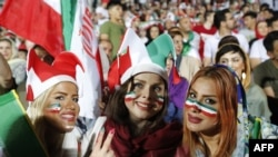 Iranian women watch the World Cup match between Portugal and Iran at Azadi Stadium in Tehran on June 25, 2018.