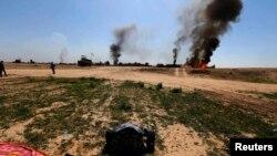 Pamje nga luftimet e forcave qeveritare kundër militantëve të Shtetit Islamik në Irak