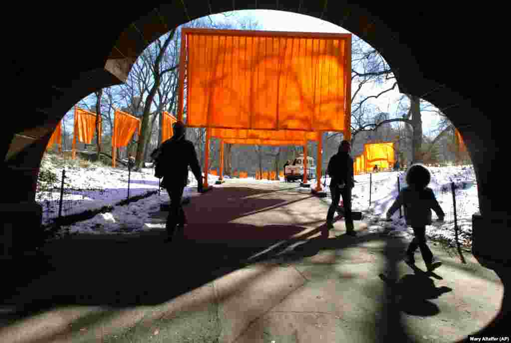 Visitors walk under a section of The Gates in Central Park in 2005.