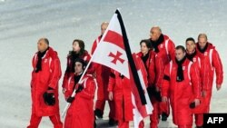 Members of the Georgian Olympic team wore black armbands and a black stripe graced the Georgian flag during the opening ceremonies of the Winter Olympics in Vancouver.