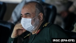 IRAN -- Iranian revolutionary guard chief Hossein Salami wearing a face mask attends a wargame in Strait of Hormuz, July 28, 2020