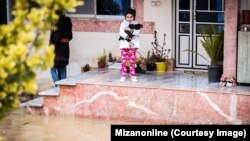 A man with a small girl, flood in Mazandaran, March 2019 floods