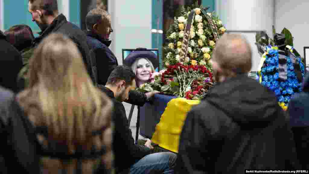 A portrait of flight attendant Maria Mykytyuk is seen on her coffin. She was 24 years old.