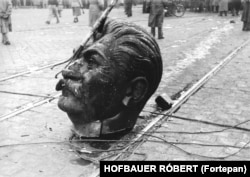 The battered head of Budapest's Stalin statue after being dragged through the streets. The 1956 uprising began with a student protest and flared into a full-scale rebellion against Hungary's communist regime.