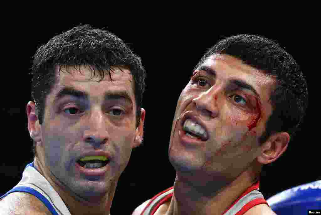 Boxer Shakhobidin Zoirov of Uzbekistan (right) beat two-time Russian world champion Mikhail Aloyan to win gold in the flyweight division.