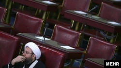 Iran judiciary chief Ayatollah Sadegh Larijani listens to a speech in the Assembly of Experts in February.