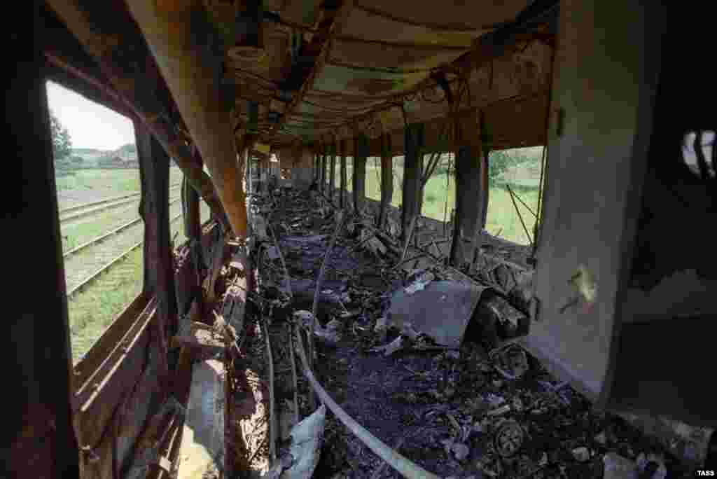 The scorched interior of a train carriage.