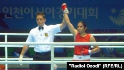 Tajik boxer Mavzuna Chorieva after a victory in the Asian Games in South Korea in 2014.