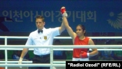 Tajik boxer Mavzuna Chorieva defeated Ayako Minova from Japan in1st raund of women boxing competition in Asian Games, South Kore, 27.09.2014