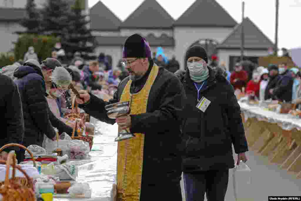 An Orthodox priest blesses believers during Easter celebration in Minsk.