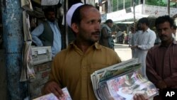 A Pakistani vendor sells local magazines carrying news of Al-Qaeda leader Osama bin Laden's death at the hands of U.S. forces in Abbottabad.