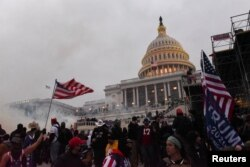 "Kremlin-aligned commentators suggested that the United States was getting its own ""color revolution"" following this week's violence at the U.S. capitol."