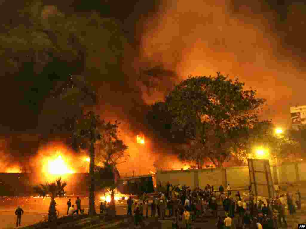 Protesters gather around the burning headquarters of the ruling National Democratic Party (NDP) in central Cairo.