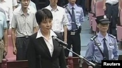 A TV grab shows Gu Kailai, wife of ousted Chinese Communist Party Politburo member Bo Xilai, standing in court in Hefei.