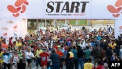 File - Participants attend the first international Tehran marathon at Azadi Square in Tehran, April 7, 2017