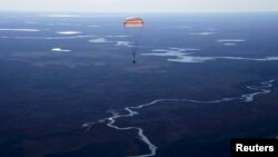 Russia's Soyuz MS-02 space capsule carrying the International Space Station (ISS) crew members, NASA astronaut Shane Kimbrough and cosmonauts Sergey Ryzhikov and Andrey Borisenko of the Russian space agency Roscosmos, descends before landing.
