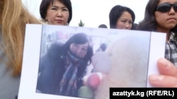 Protesters against the practice show a photograph during a Karakol, Kyrgyzstan rally of a kidnapped bride. (file photo)