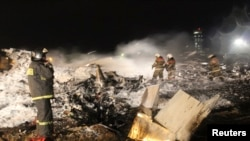 Emergencies Ministry members and firefighters work at the site of a Tatarstan Airlines Boeing 737 crash at Kazan airport on November 17.