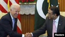 U.S. Vice President Joe Biden (left) shares a laugh while sitting down to meet with Pakistan's President Asif Ali Zardari in Islamabad