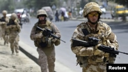 British soldiers patrol a street in Kabul.