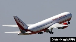 AUSTRIA -- A Vision airlines plane takes off after apparently carrying out a spy swap at Vienna airport in Vienna, July 9, 2010