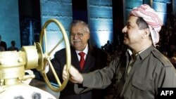 Iraqi President Jalal Talabani (left), a Kurd, and Kurdish regional President Mas'ud Barzani open a ceremonial valve during an event to celebrate the start of oil export from Kurdistan in June.