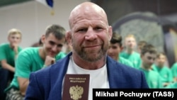 Jeff Monson poses with his Russian passport in June.