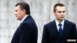 Viktor Yanukovych (left) and his son Oleksandr (file photo)