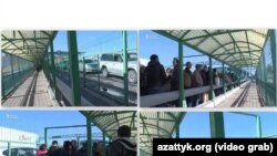 Қазақ-қырғыз шекарасындағы бекетте кезекте тұрған адамдар. Видеодан скриншот.
