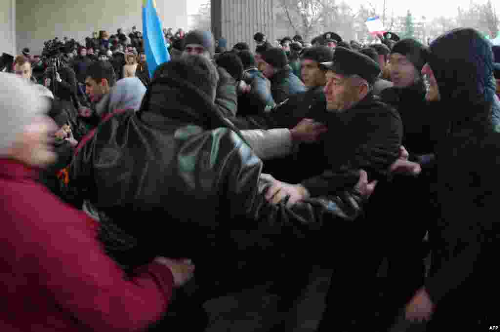 Pro-Ukrainian activists fight with pro-Russian activists.