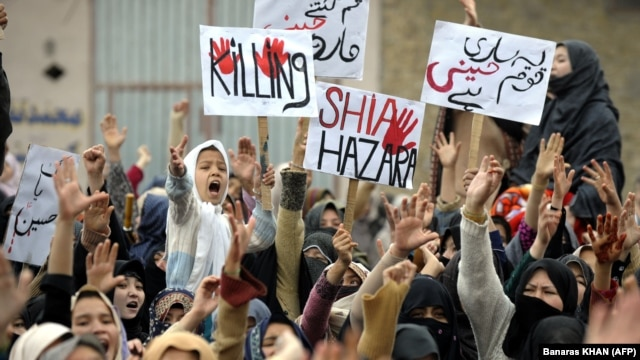 Shi'ite Muslims protest on February 18 against a bombing that killed 89 people in Quetta two days earlier. Some are questioning if the authorities are able, or even willing, to stop those behind it and other attacks.