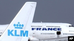 FILE -- In this Sept. 30, 2003 file photo, an Air France jumbo jet rolls behind the tail of a KLM Royal Dutch airliner at Charles de Gaulle airport in Roissy, north of Paris. KLM said Wednesday, Sept. 14, 2016 that it will temporarily suspend flights to a