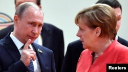 German Chancellor Angela Merkel (right) talks to Russian President Vladimir Putin at the start of the first working session of the G20 meeting in Hamburg in July 2017.