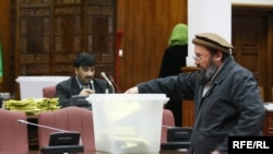 An Afghan lawmaker casts a ballot during the January 2 session that blocked many of Karzai's ministerial choices.