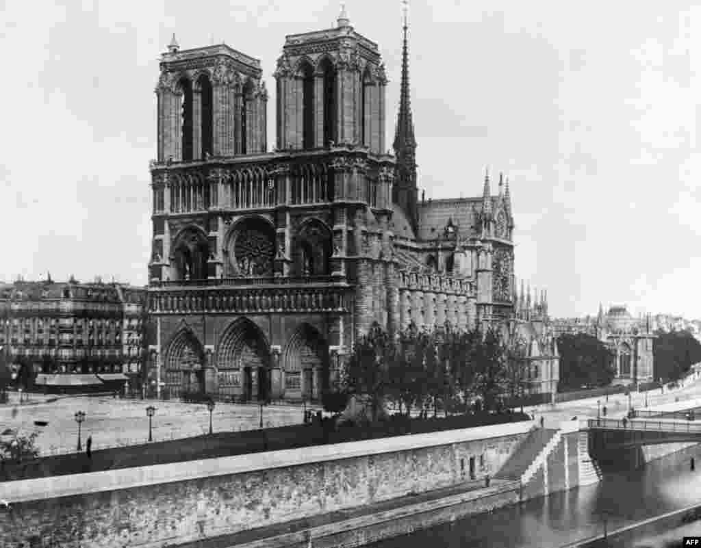 The cathedral on the island in the River Seine, the Ile de la Cite, is seen in a photo from 1911.