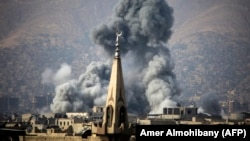Дым над пригородом Дамаска. Архивное фото