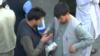 Afghanistan - money exchange - video on economic collapse - Reuters