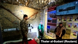 IRAQ -- A member of Hashid Shaabi looks at the Popular Mobilisation Forces (PMF) section of the Baghdad International Fair in Baghdad, November 10, 2018