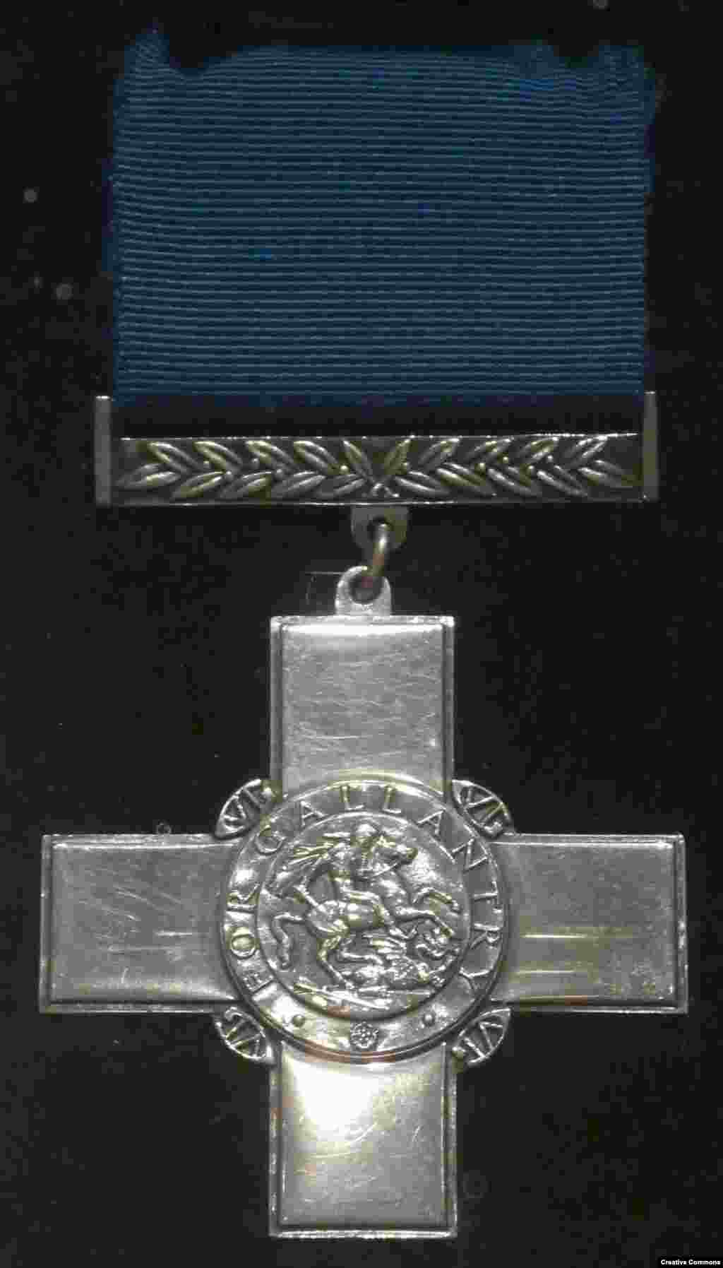 "The United Kingdom's George Cross   Among the hundreds of recipients of this award ""for acts of the greatest heroism,"" perhaps the most unusual is the island of Malta, which was awarded the cross in 1942 for ""heroism and devotion"" during the Nazi/Italian siege of the British colony in World War II. The cross was later incorporated into the top left corner of independent Malta's flag."