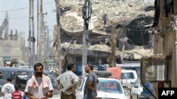 A street lined with collapsed and crumbling buildings in the Shi'ite stronghold of Sadr City in Baghdad.