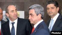 Armenia - Outgoing President Robert Kocharian (L), President-elect Serzh Sargsyan (C) and Central Bank Chairman Tigran Sarkisian attend the inauguration of a commercial bank headquarters in Yerevan, 4Apr2008.