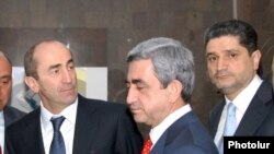 Armenia - Outgoing President Robert Kocharyan (L), President-elect Serzh Sargsyan (C) and Central Bank Chairman Tigran Sarkisian attend the inauguration of a commercial bank headquarters in Yerevan, 4Apr2008.