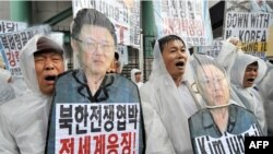 Conservative activists shout slogans at a rally supporting UN sanctions on North Kore in Seoul.