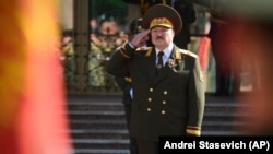 Alyaksandr Lukashenka salutes during his inauguration ceremony in Minsk on September 23, more than a month after a much-disputed presidential vote that according to official figures he won by a landslide.